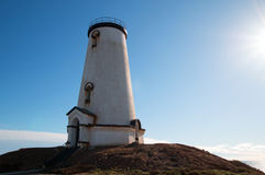 Lighthouse shining in the afternoon sun at Piedras Blancas point on the Central California Coast north of San Simeon California Stock Photos