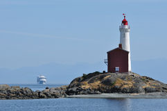 Lighthouse and ship. Historic fisgard lighthouse and ship in vancouver island, built in 1860, victoria, british columbia, canada Stock Image