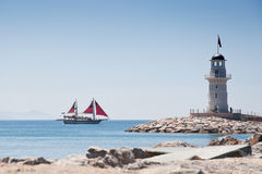Lighthouse and ship. View on a Alanya lighthouse from the beach Stock Photos