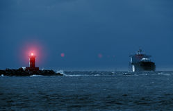Lighthouse and The Ship Royalty Free Stock Photos