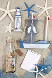 Lighthouse, ship, bottle and sea stars Stock Images