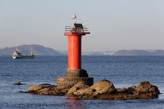 Lighthouse and ship Royalty Free Stock Photo