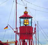 Lighthouse ship in harbor Stock Photo
