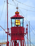 Lighthouse ship in harbor Stock Image
