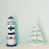 Lighthouse and ship model for decorated in room Stock Photos