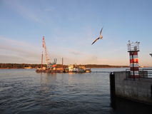 Lighthouse and ships in  Klaipeda, Lithuania Royalty Free Stock Photo