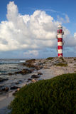 Lighthouse and shore Stock Image