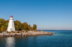 Lighthouse on shore of lake Huron Stock Photo