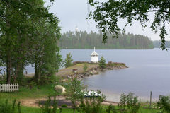 Lighthouse on the shore of lake Royalty Free Stock Photography