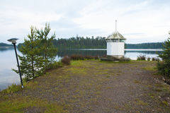 Lighthouse on the shore of lake Royalty Free Stock Image