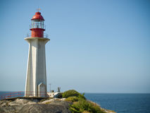 Lighthouse and shoreline Royalty Free Stock Photo