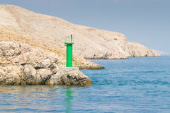 Lighthouse that signals the presence of rocks at ships. Stock Image