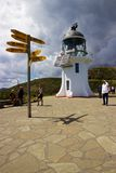 Lighthouse and signpost at Cape Reinga, Northland, New Zealand Stock Image