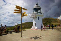 Lighthouse and signpost at Cape Reinga, Northland, New Zealand Royalty Free Stock Photography