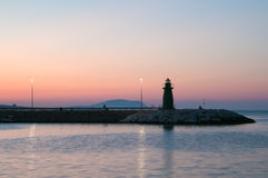 Lighthouse silhouette of Civitanova Marche. At sunset Stock Photos