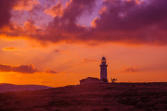 Lighthouse silhouette in Pahpos, Cyprus. Stock Photo