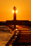 Lighthouse silhouette at the sunset. In summer stock photos