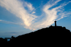 Lighthouse silhouette at sunset Royalty Free Stock Photo