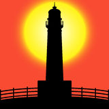 Lighthouse silhouette at Sunset Royalty Free Stock Photography