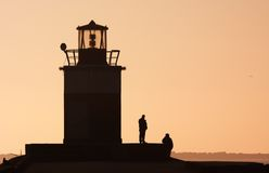 Lighthouse silhouettes Stock Images