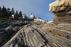 Lighthouse Sits on Unique Rock Formations Stock Photography