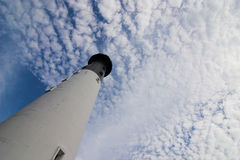 Lighthouse and sky. Lighthouse seen from wide angle lens with room for text in sky stock images
