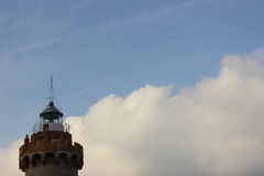 Lighthouse between sky and clouds Royalty Free Stock Images