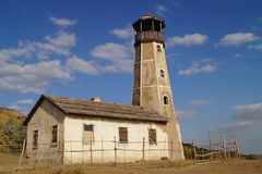 Lighthouse. Sky. Old building. Scenery for the filmÑŽ royalty free stock image