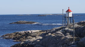 Norwegian Lighthouse. Small lighthouse at the coast of Norway royalty free stock photos