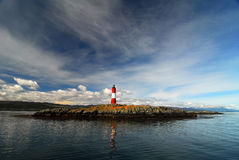 Lighthouse on a small island royalty free stock photos