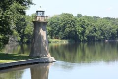 Lighthouse. Small lighthouse on the river in the daytime Royalty Free Stock Image