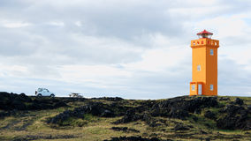 Lighthouse in Snaefellsnes, Iceland. Fourwhell drive to orange lighthouse in Snaefellsnes, Iceland stock image
