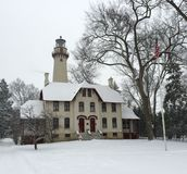 Lighthouse in a Snowstorm Stock Images
