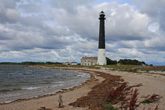 Lighthouse. Sorve lighthouse on island Saaremaa in Estonia. Scenic view with rainy sky in background stock photography