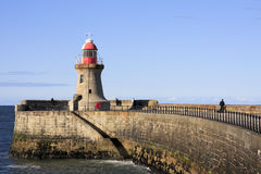 Lighthouse and South Pier. The stubby Lighthouse on the South Pier at the mouth of the River Tyne. South Shields Tyne and Wear, England, UK Stock Images