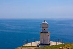 Lighthouse by a sparkle day Royalty Free Stock Image