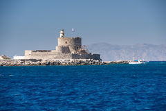 Lighthouse St. Nicholas at Rhodes, Greece. Royalty Free Stock Photos