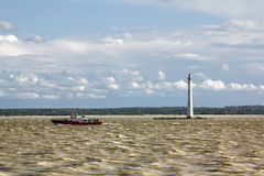 Lighthouse St. Petersburg sea port in the Gulf of Finland at the Royalty Free Stock Photography