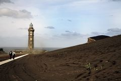 Lighthouse stands in lava field royalty free stock photo