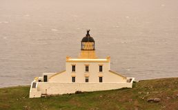 Lighthouse, Stoer, Scottish highlands. This image shows the Stoer lighthouse building, on the cliff edge, overlooking the Atlantic ocean. Although the building Royalty Free Stock Images