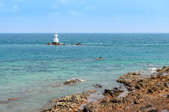 Lighthouse on the stone and sea Stock Image