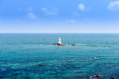 Lighthouse on the stone and sea Royalty Free Stock Images