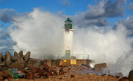Lighthouse in storm. Lighthouse -  cloudy sky and storm, big waves Stock Image