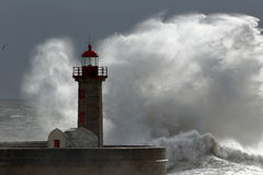 Lighthouse storm. Big wave over old lighthouse, Porto, Portugal Stock Photo
