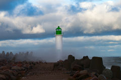 Lighthouse in storm. Royalty Free Stock Images
