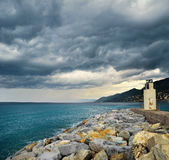 Lighthouse with storm dark clouds Stock Photos