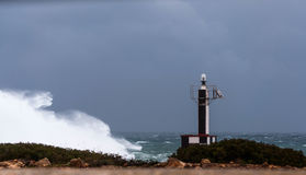 The lighthouse and the storm stock photo