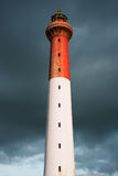 Lighthouse with stormy clouds Stock Image