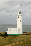 Lighthouse on a stormy day. Hurst Point High Lighthouse, built in 1812, Hampshire, England Stock Image