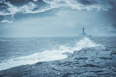Lighthouse on a stormy day, artistic toned photo Royalty Free Stock Image